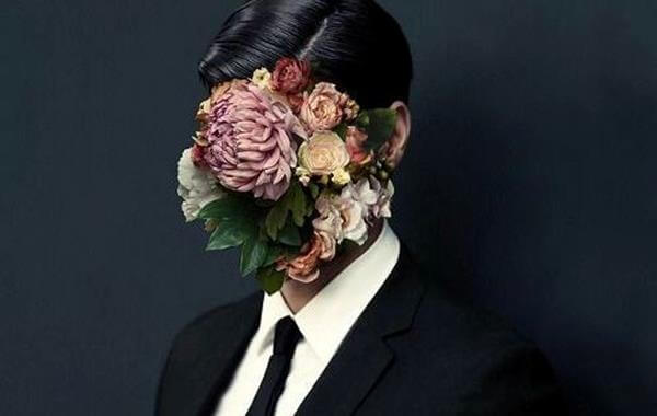 man-with-flowers-covering-face