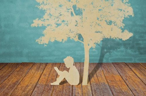 paper-cutout-child-reading-under-tree