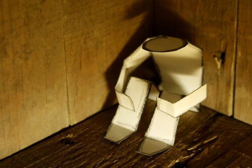 paper man sitting in a corner