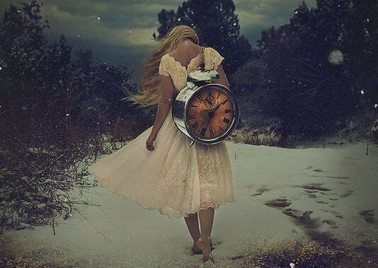 woman carrying a clock