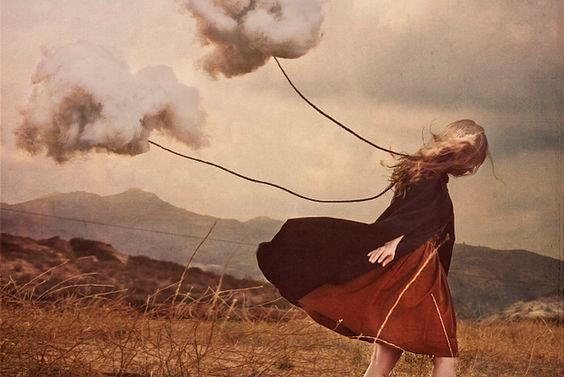 woman-with-clouds-tied-to-a-string