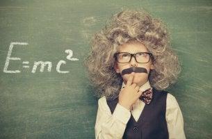 boy-dressed-like-einstien-solving-a-problem