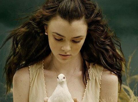 girl holding bird