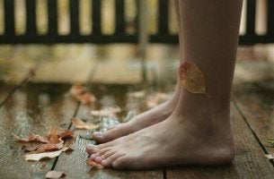 bare-feet-with-leaves-blowing