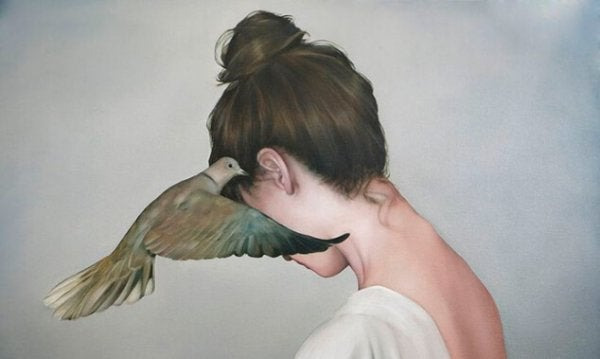 bird whispering to woman