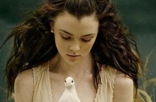 girl holding dove