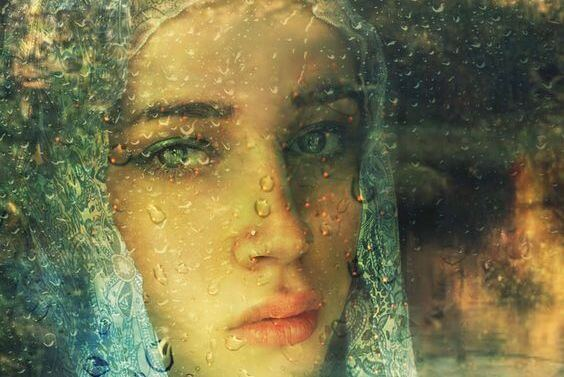 sad-woman-wet-window