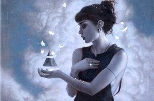 woman holding pyramid