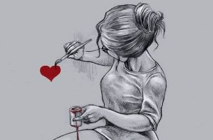 woman painting heart