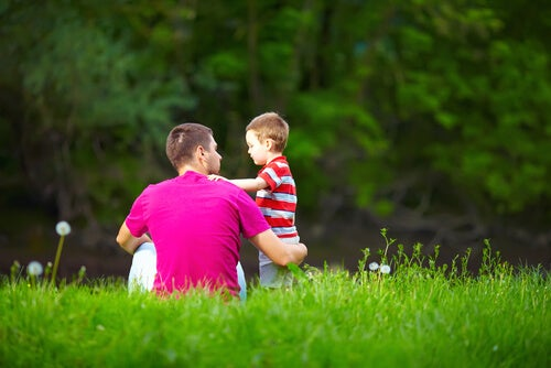 Son and Dad in Grass