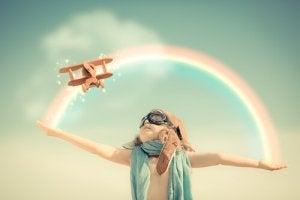 child airplane rainbow