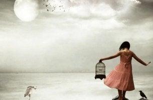 girl holding birdcage