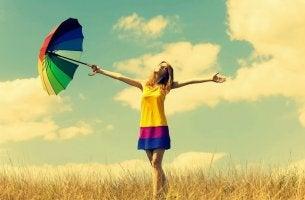 happy woman with umbrella
