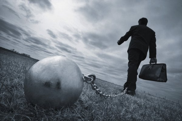 man chained to ball