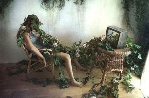 woman covered in branches