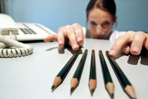 woman fixing pencils