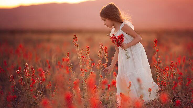girl-in-a-field-of-red-flowers