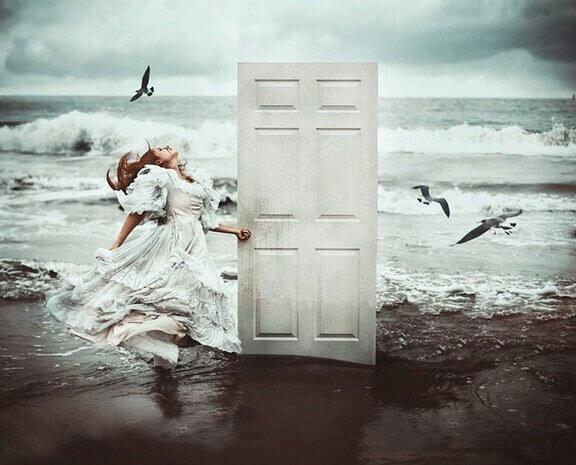 girl-on-beach-with-door