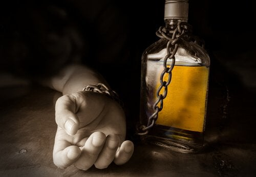 hand-chained-to-a-bottle-of-alcohol