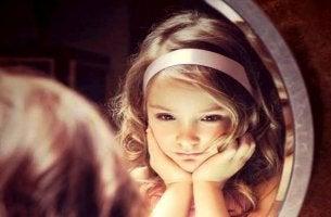 upset-girl-looking-in-mirror