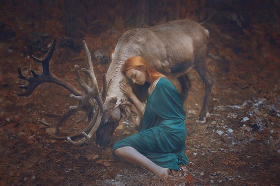 woman hugging deer