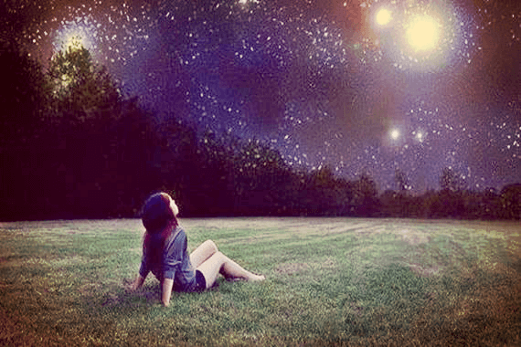 girl looking at starry sky