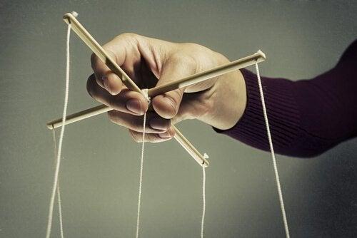 man holding marionette strings