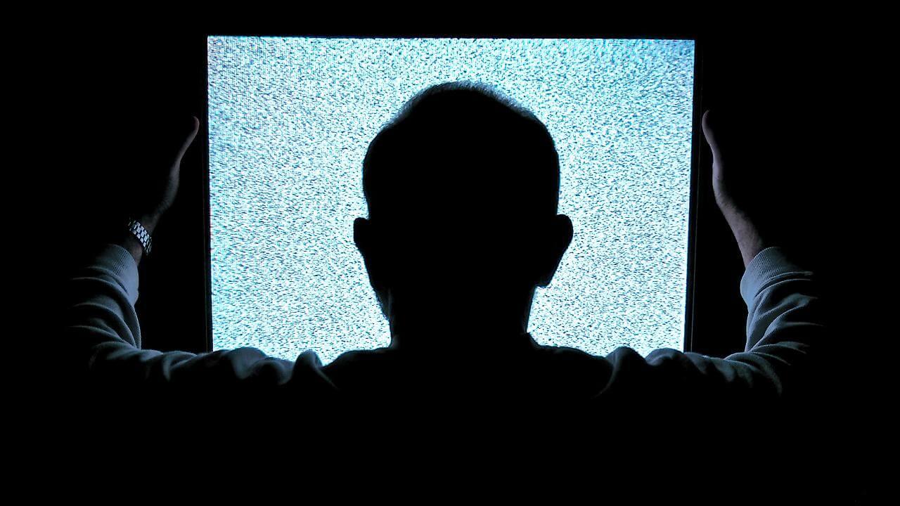 man staring at blank screen