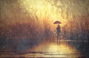 woman standing alone in the rain