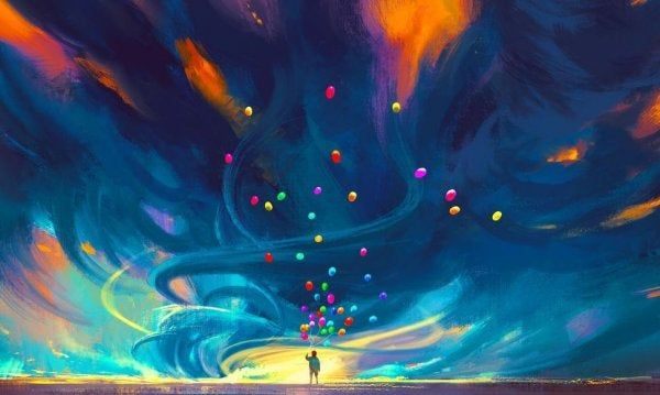 balloons flying into colorful sky