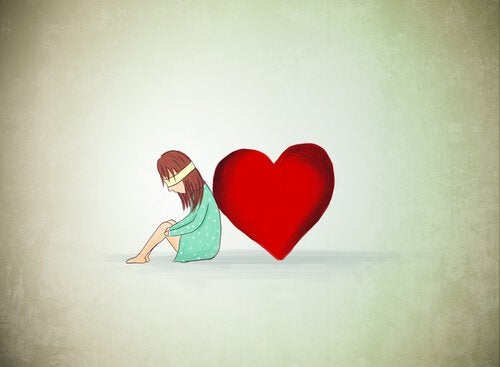 blindfolded girl leaning against heart