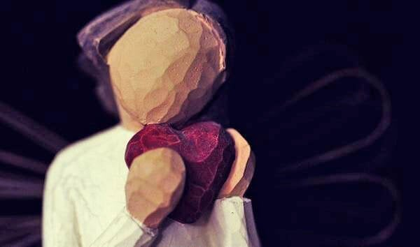 wooden figure with heart