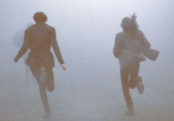 couple running in the mist