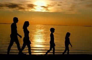 silhouette of a family walking