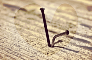 two nails surrounded by a heart
