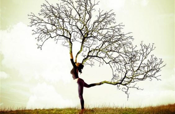 woman with branches as limbs
