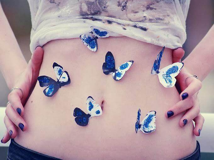 butterflies on girls abdomen