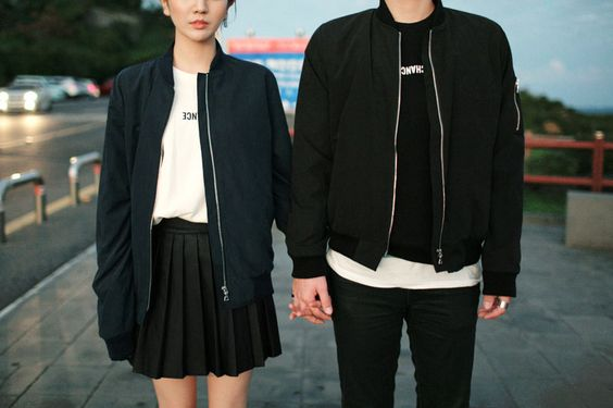 couple dressed in black holding hands