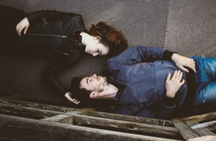 couple laying on ground