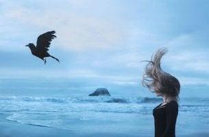 girl and bird at beach