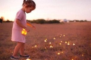 girl collecting fireflies