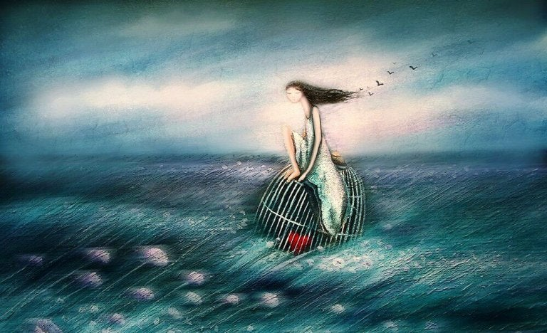 girl floating on a caged heart in the ocean