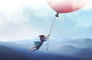 girl flying on balloon