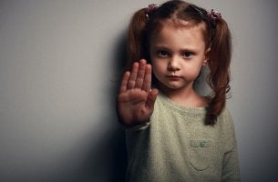 little girl saying stop