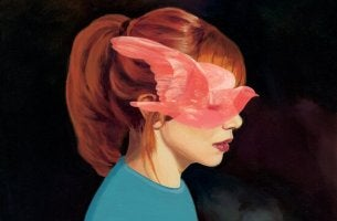 redhaired girl with bird in face