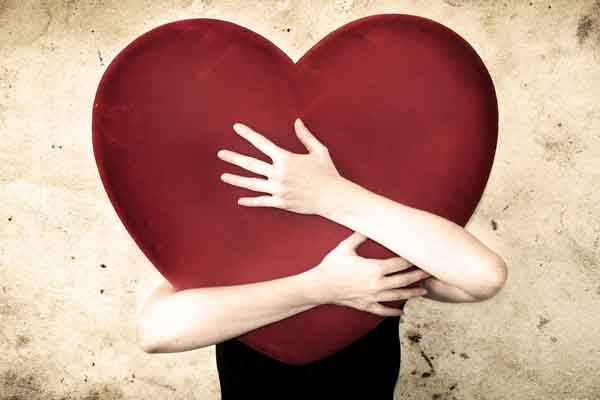 someone hugging giant heart