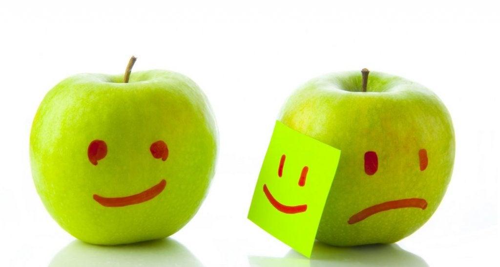 two apples one happy one sad