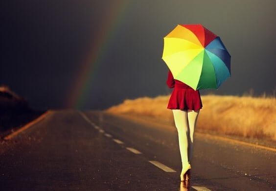 ballerina on street with colorful umbrella
