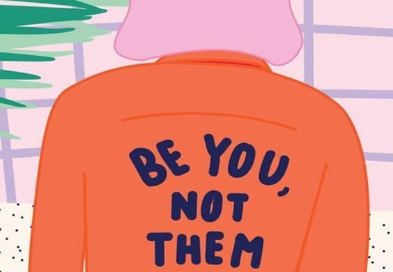 "The back of a jacket reads ""Be you, not them""."