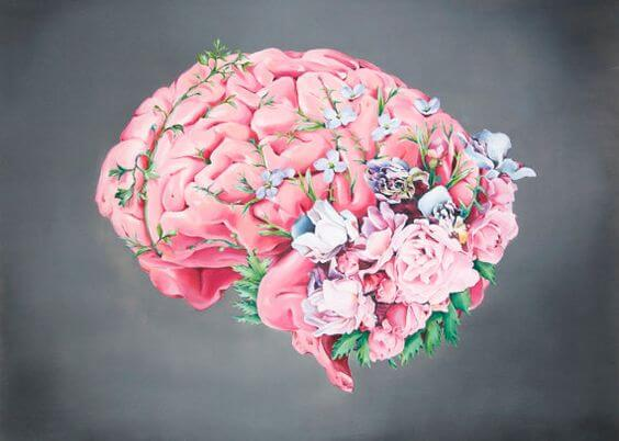 A brain is covered in colorful flowers.